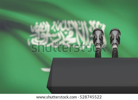 Pulpit and two microphones with a flag on background - Saudi Arabia