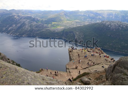 Pulpit Rock at Lysefjorden in Norway. A well known tourist attraction towering 604 meters over sea level. - stock photo