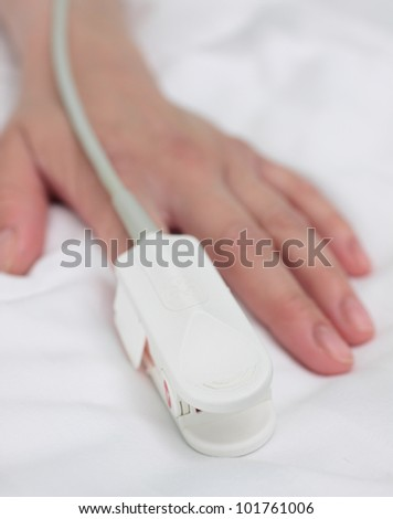 pulse oximeter on the patient's hand. photo. Medical background. - stock photo