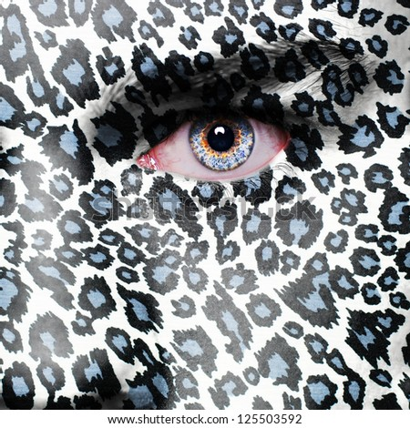 Puma pattern on man face - stock photo