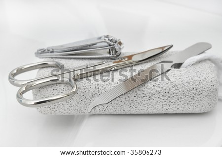Pumice stone and nail scissors