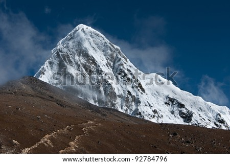Pumori, Kala Patthar and cloudy sky in Himalayas. Nepal (shot on height 5100-5200 m) - stock photo