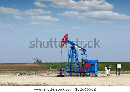 pump jack on field oil industry - stock photo