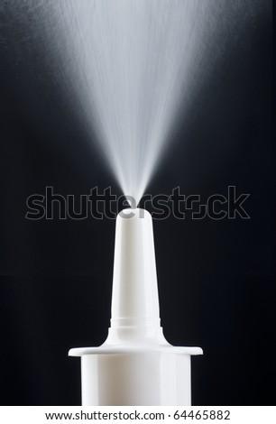 Pump nasal spray in action - stock photo