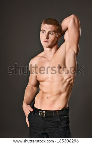 pumped young guy with a naked torso - stock photo