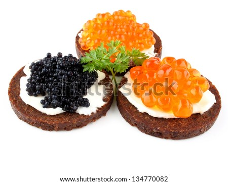 Pumpernickel bread with red and black caviar, close up - stock photo