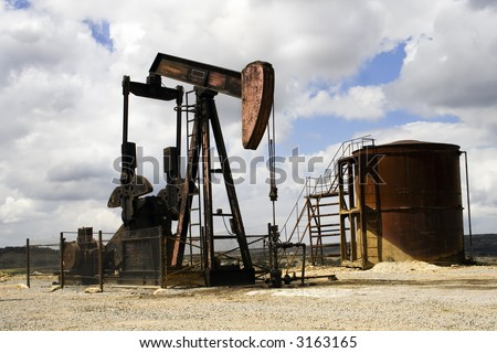 Pumpjack extracting petrol in a Spanish landscape. - stock photo