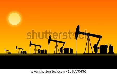 Pumpjack pumping crude oil  - stock photo