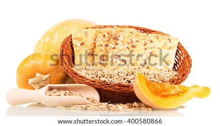 Pumpkin, a bowl of biscuits with sunflower seeds, sesame and flax isolated on white background. - stock photo