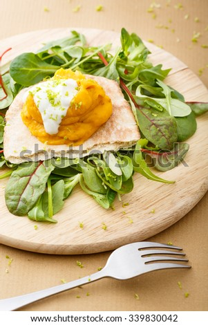 pumpkin and apple puree on a piece of the puff bread and a fork on the table - stock photo