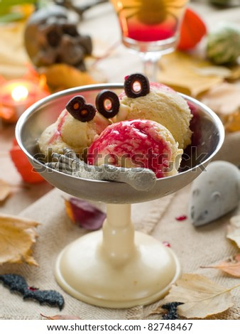 Pumpkin-apple ice - cream with bloody sauce for Halloween party. Selective focus - stock photo