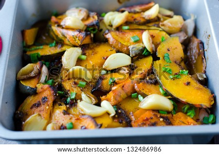 Pumpkin baked with garlic and spices - stock photo