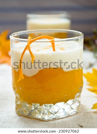 Pumpkin cream and thick greek yougurt with grapefruit peels - stock photo