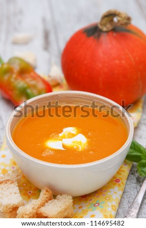 Pumpkin cream soup with sour cream sauce