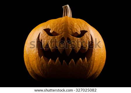 Pumpkin for Halloween on a black background - stock photo