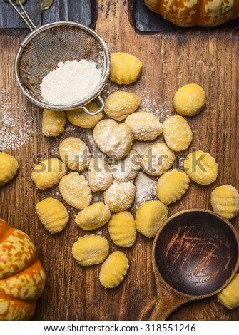 pumpkin gnocchi  Ingredients for cooking on ?utting board on dark rustic background  close up top view - stock photo