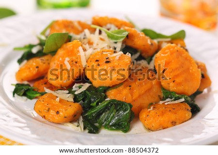 Pumpkin gnocchi with spinach and parmesan cheese