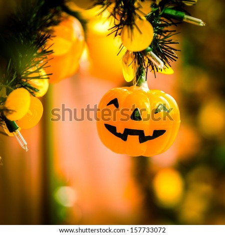 Pumpkin halloween lamp decorated in party - stock photo
