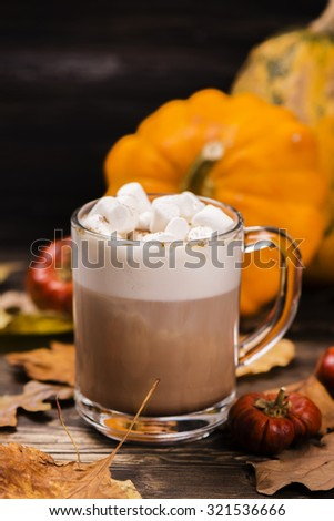 Pumpkin latte with marshmallows. Selective focus - stock photo