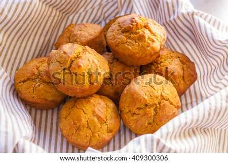 Pumpkin muffins straight out of the oven - stock photo