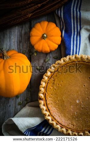Pumpkin pie on rustic background - stock photo