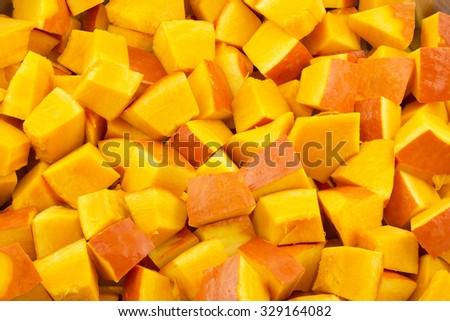 Pumpkin pieces as food background - stock photo