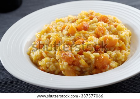 Pumpkin risotto in a bowl closeup - stock photo
