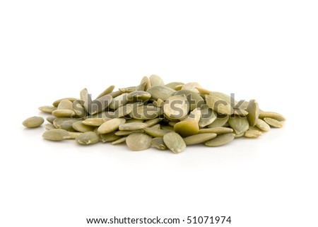 Pumpkin seed, isolated on white background. - stock photo
