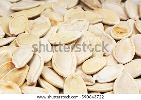 Pumpkin seed texture. Pumpkin seeds pattern as background.