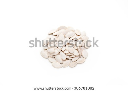 Pumpkin seeds isolated on white background. - stock photo