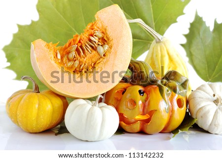 pumpkin slice with decorative halloween pumpkins