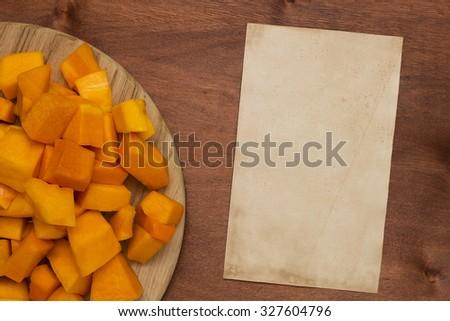 Pumpkin sliced on a cutting board kitchen. - stock photo