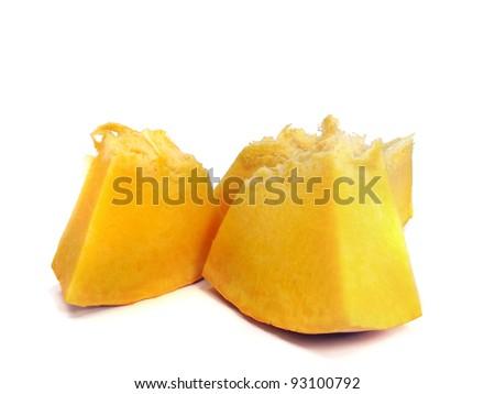 Pumpkin slices on white background - stock photo