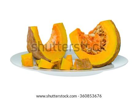 Pumpkin slices on white plate - stock photo