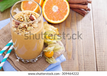 Pumpkin smoothie topped with pumpkin granola for breakfast - stock photo