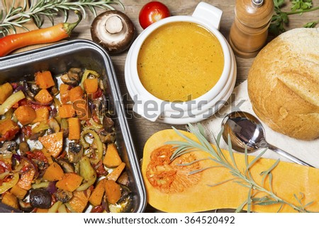 Pumpkin soup and vegetable stew with home made bread - stock photo