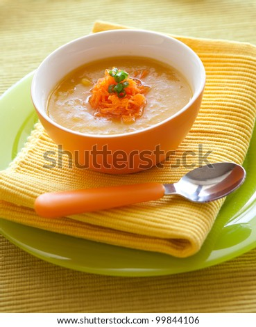 Pumpkin soup from carrots, potatoes and pumpkin decorated with onion