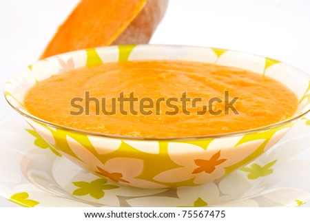 pumpkin soup in a bowl on a white background