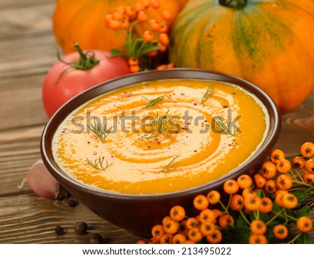 Pumpkin soup on brown background - stock photo