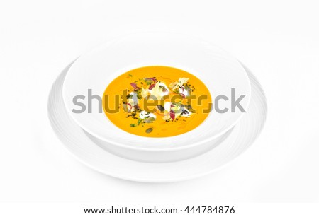 Pumpkin soup with cream cheese on a white background - stock photo