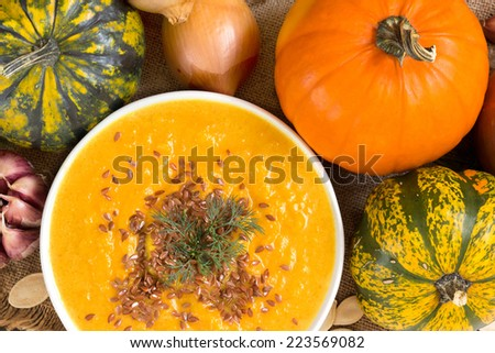 Pumpkin soup with ingridients - top view - stock photo