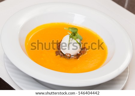 pumpkin soup with mushrooms and cream cheese - stock photo