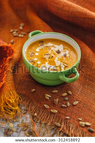 Pumpkin soup with seeds - stock photo