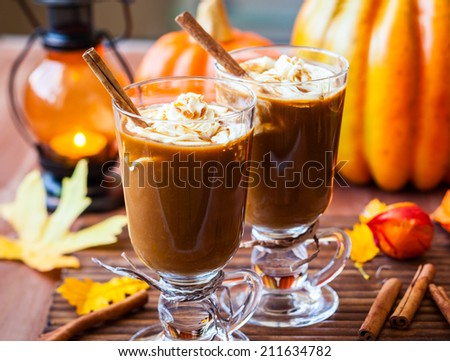 Pumpkin spice coffee with whipped cream and caramel - stock photo