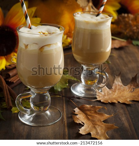 Pumpkin spice latte with whipped cream and caramel - stock photo