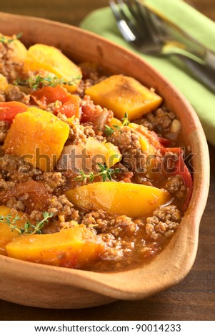Pumpkin, tomato, mincemeat dish with fresh thyme (Selective Focus, Focus one third into the dish) - stock photo