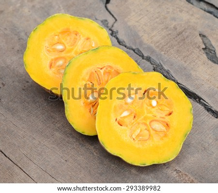 pumpkin vegetable on wooden board - stock photo