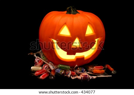 Pumpkin with candy - stock photo