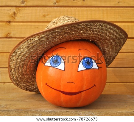 Pumpkin with female face in a straw hat against wooden boards, photo by a Halloween - stock photo