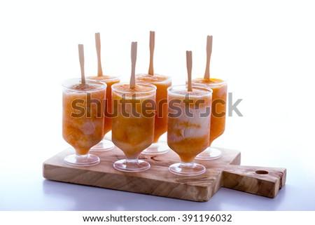 Pumpkin yogurt freeze, homemade healthy and tasty frozen pops - stock photo